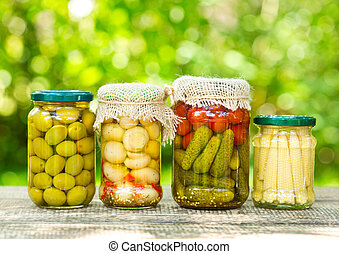 preserved vegetables on wooden table