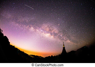 The Milky Way rises over the silhouettes pagoda in Thailand...