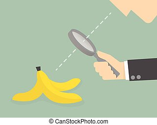 banana - Businessman looking to a banana peel through a...