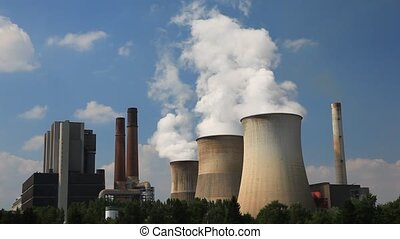 Nuclear power plant cooling towers blowing steam into the...