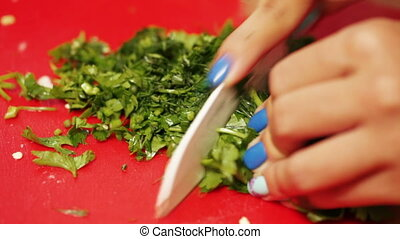 Cutting parsley on lettuce - On plastic chalkboard girl with...