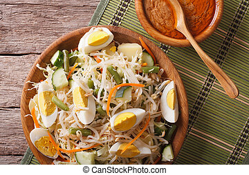 Gado Gado salad with peanut sauce close-up horizontal top...