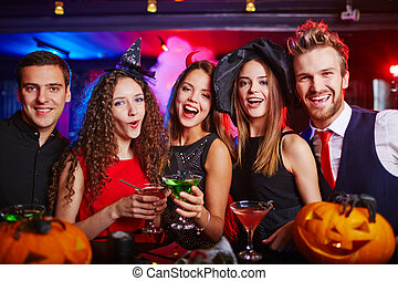 Cheerful Halloween night - Young people cheering at...