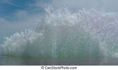 Waves Breaking on the Breakwater, a Wall of Water Rises and...