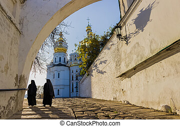 Kiev-Pechersk Lavra in autumn. Path along the wall with a...