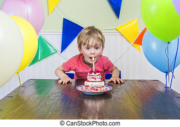 Adorable kid's birthday party - Adorable kid blowing out the...