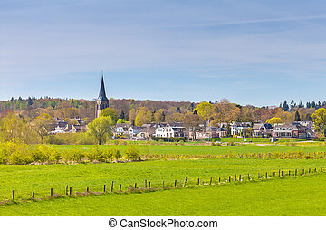 The small Dutch village of Dieren in front of the Veluwe -...