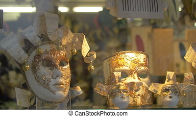 Handmade masks for Venetian carnival in glass shop-window