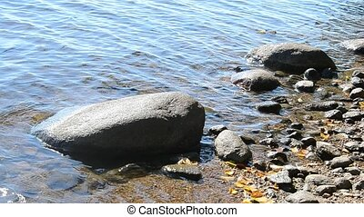 Shores of a lake with rock - Shores of a lake with rock at...
