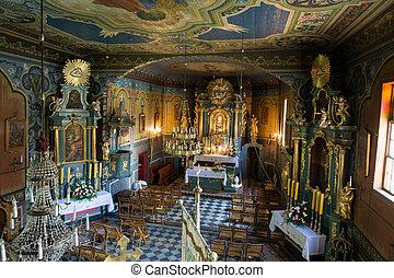 Interior of the wooden antique church in Podstolice near...