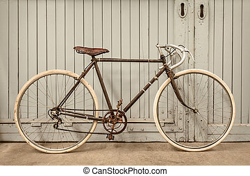 Vintage racing bicycle in an old factory - Vintage rusted...