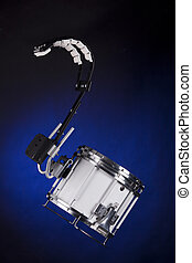 Marching Field Drum Isolated On Blue - A white marching...