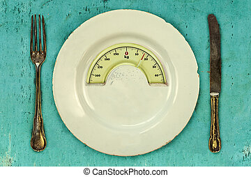 Plate with a weight balance scale Diet concept - Plate with...