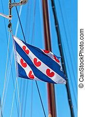 Dutch Frisian flag on a sailing ship - Dutch flag of the...