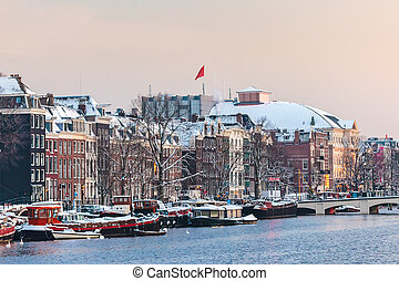 Amsterdam winter view with the river Amstel in front during...