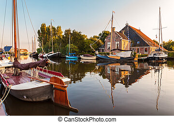 Sailing boats in the Dutch province of Friesland during...