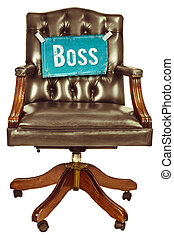 Retro office chair with boss sign isolated on white