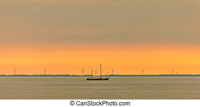 Panoramic image of a sailing boat at the Dutch Markermeer...
