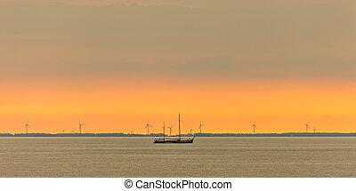 Panoramic image of a sailing boat at the Dutch Markermeer...