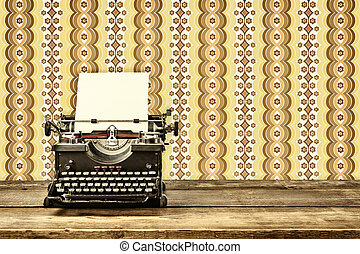 Retro styled image of an old typewriter with blank paper...