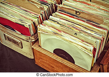 Retro styled image of vinyl lp records on a flee market -...