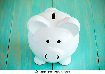 Piggy bank on the blue  background