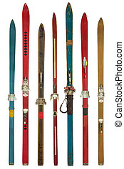 Vintage colorful used skis isolated on white
