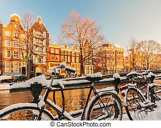Bicycles covered with snow during winter in Amsterdam -...