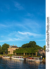 Classic small cruise boats on the famous Dutch river Vecht