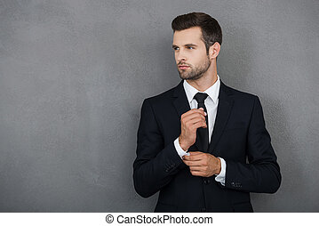 Perfect to the last detail. Handsome young businessman...