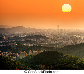 Taipei sunset with beautiful sun and buildings and famous...
