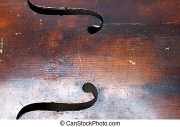 wood of violoncello - Abstract music background, G clef sign...
