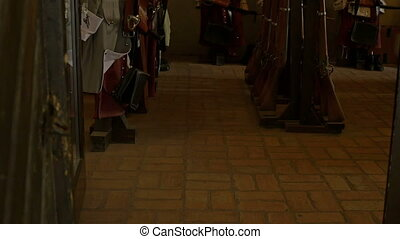 Swords and Arms Room - Dark XVIII century castle room with...