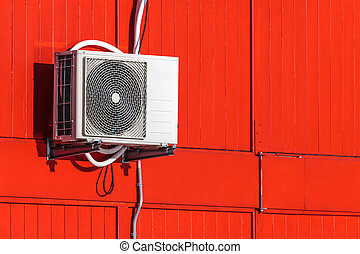 Airconditioning unit on a red wall - Exterior...