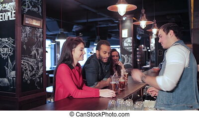 The bartender gives the drink tube in two fun girl -...