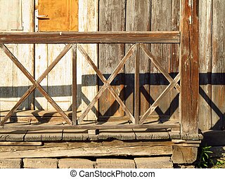 old wooden bannister of a cottage