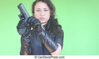 young girl shotting with gun, green
