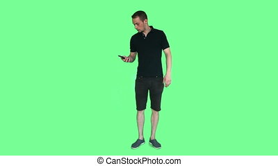 young man talking on phone green screen