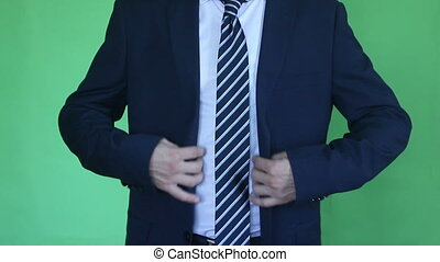 businessman arranges a suit and tie green screen