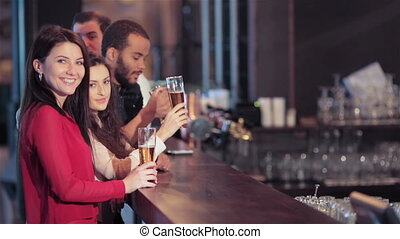 Group of girls and boys at the bar - Cheerful company of...