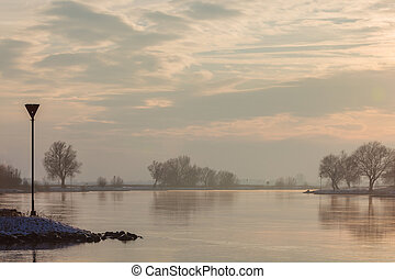 The Dutch river IJssel during sunset in winter - The Dutch...