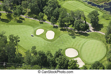Aerial view of golf course fairway and green