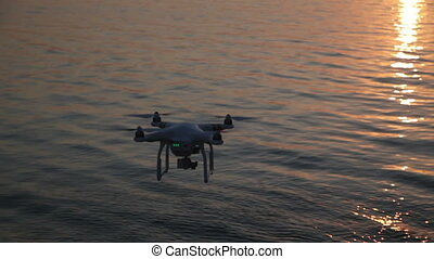 Quadrocopter Flight on The Beach at Sunset
