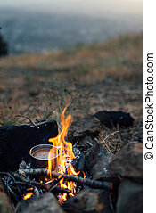 fire with  small pot of food - fire with a small pot of food