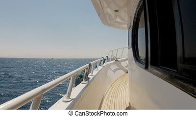 Yacht in the sea , the camera flies along the deck