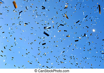 falling confetti in the city festival on blue sky background...