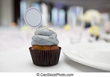Cupcake with place card on wedding table
