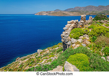 Greek sea bay with grass and bushes, Greece - View of Greek...