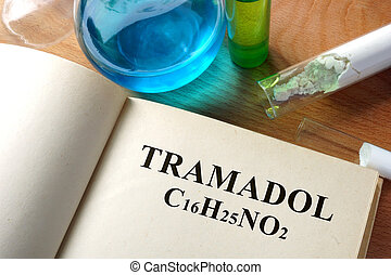 tramadol - Book with  tramadol and test tubes on a table.