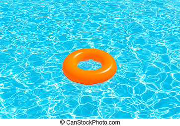 Children circle for swimming in the pool. Photo for...